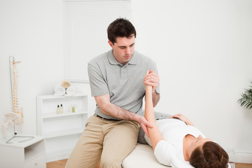 chiropractor giving exam